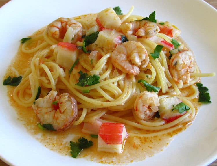 Spaghetti with shrimps and seafood delights on a plate
