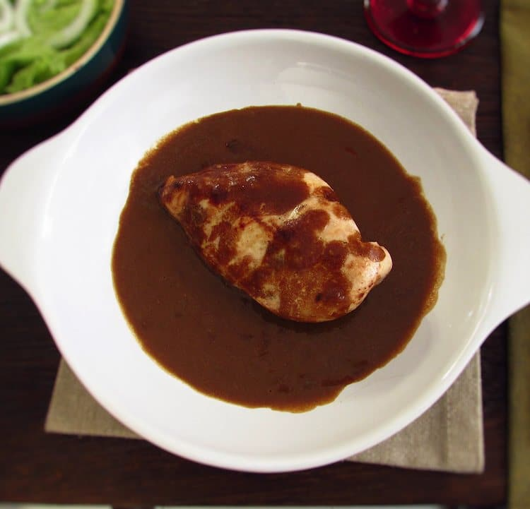 Chicken breast with coffee sauce on a dish