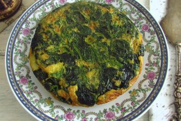 Spanish omelette with spinach on a plate
