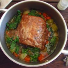 Stewed pork loin with carrot and leek in a saucepan