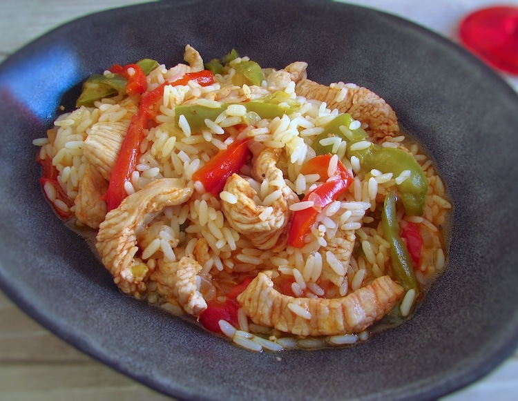 Turkey steaks with peppers and rice on a dish bowl
