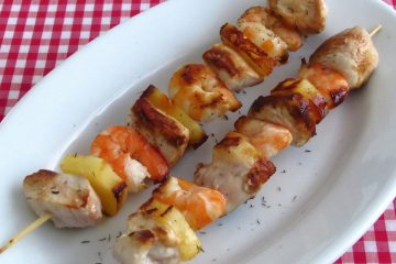 Chicken, shrimp and pineapple kebabs on a platter