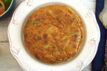 Spanish omelette with potato and tuna on a plate