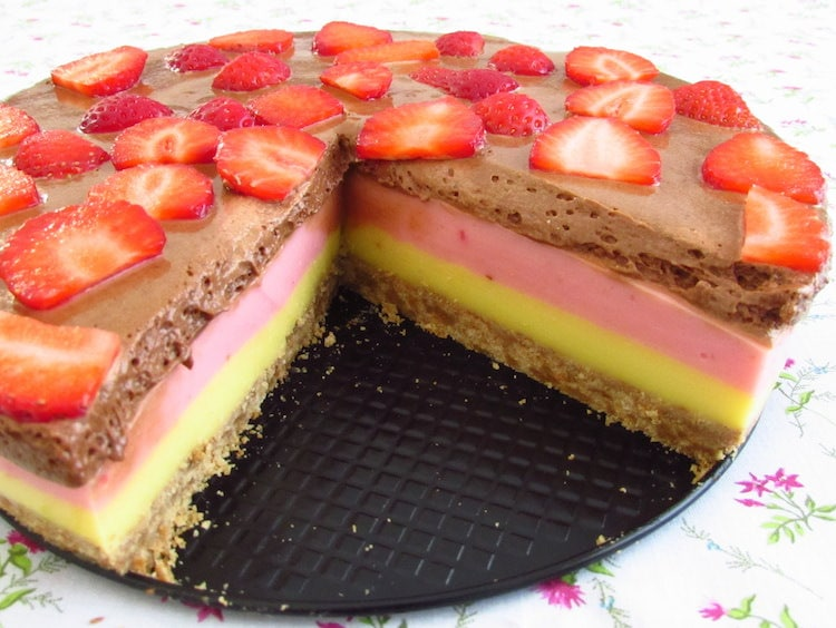Vanilla and strawberry semifreddo topped with chocolate mousse on a plate