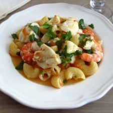 Pasta with monkfish and shrimp on a plate