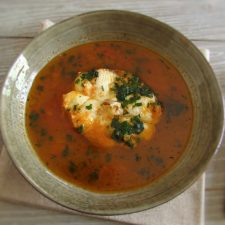 Tomato soup with dogfish on a dish