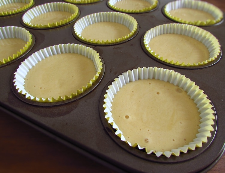 Small portions of honey muffins dough in paper liners