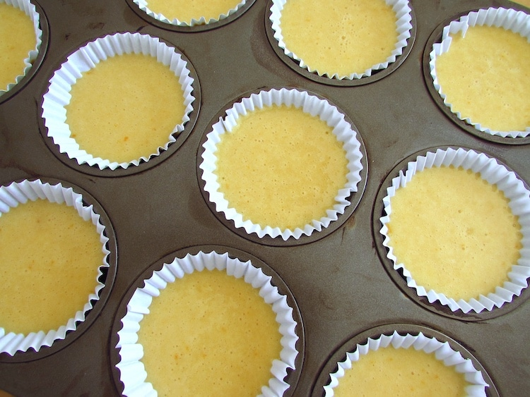 Orange and vanilla muffins dough on paper liners