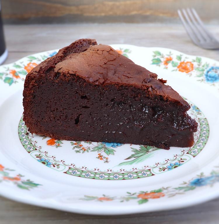 Slice of creamy chocolate cake on a dish