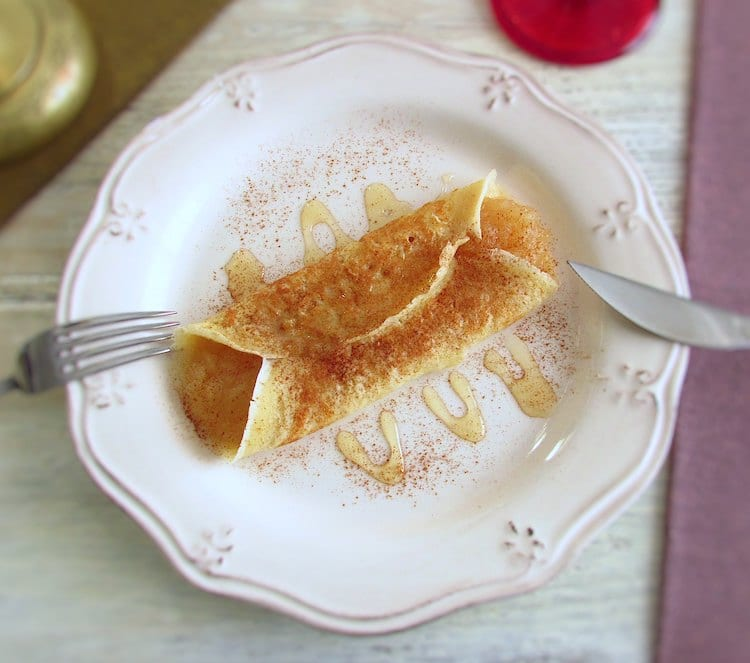 Crepe stuffed with apple jam on a plate