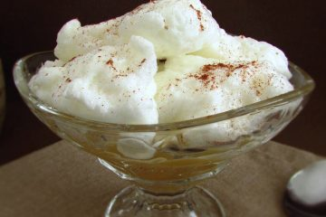 """Farófias """"Portuguese sweet"""" with apple puree on a glass bowl"""