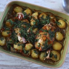 Hake in the oven with coriander on a baking dish
