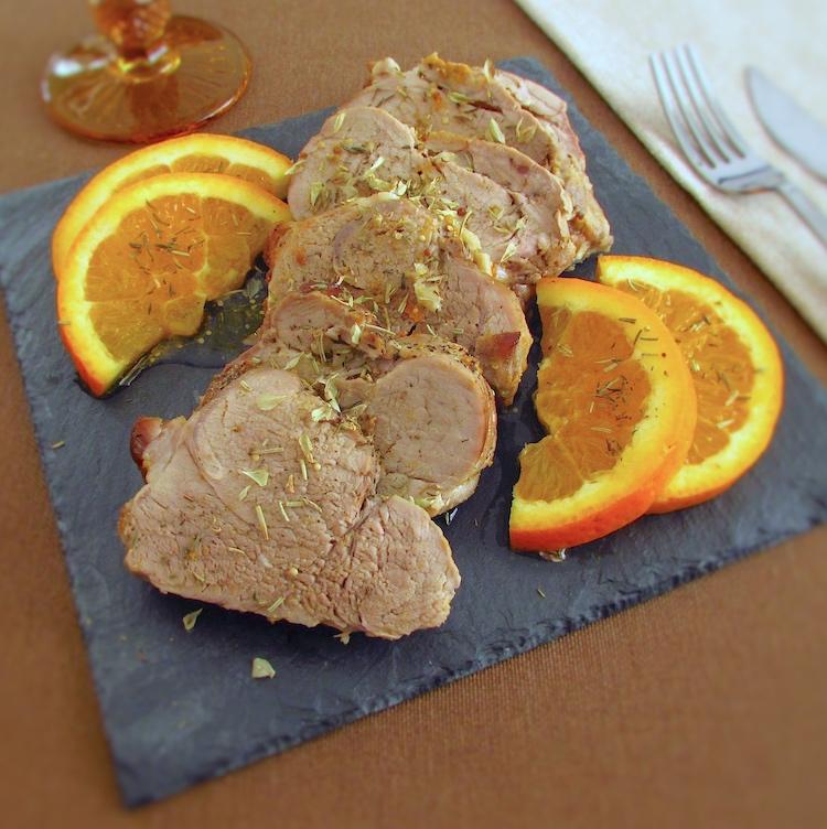 Fatias de lombo de porco com laranja
