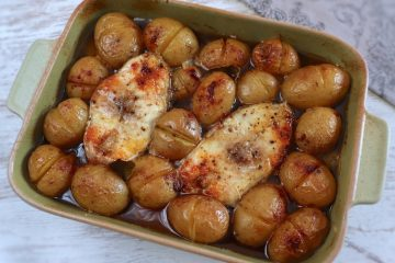 Grouper with potatoes in the oven on a baking dish