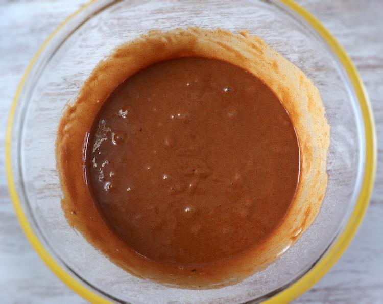 Dough of homemade cinnamon and milk cake on a glass bowl