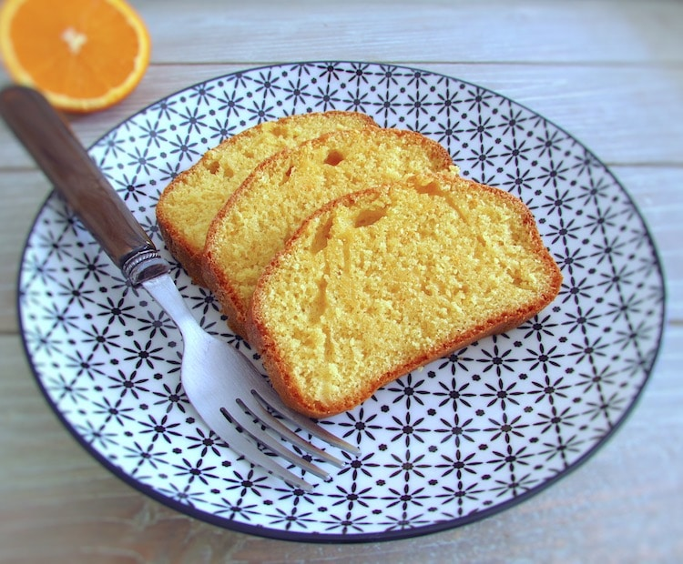 Orange and milk cake slices on a plate