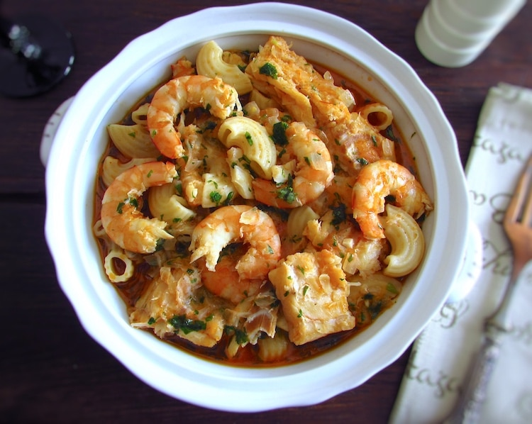 Pasta with cod and shrimp on a tureen