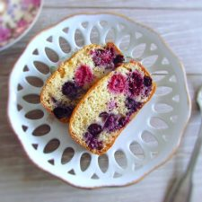 Slices of yogurt cake with berries on a dish