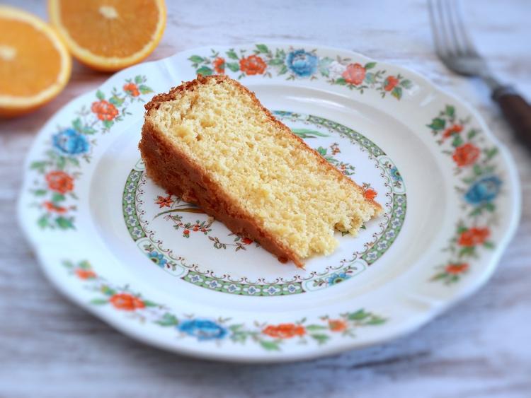 Orange sponge cake slice on a plate