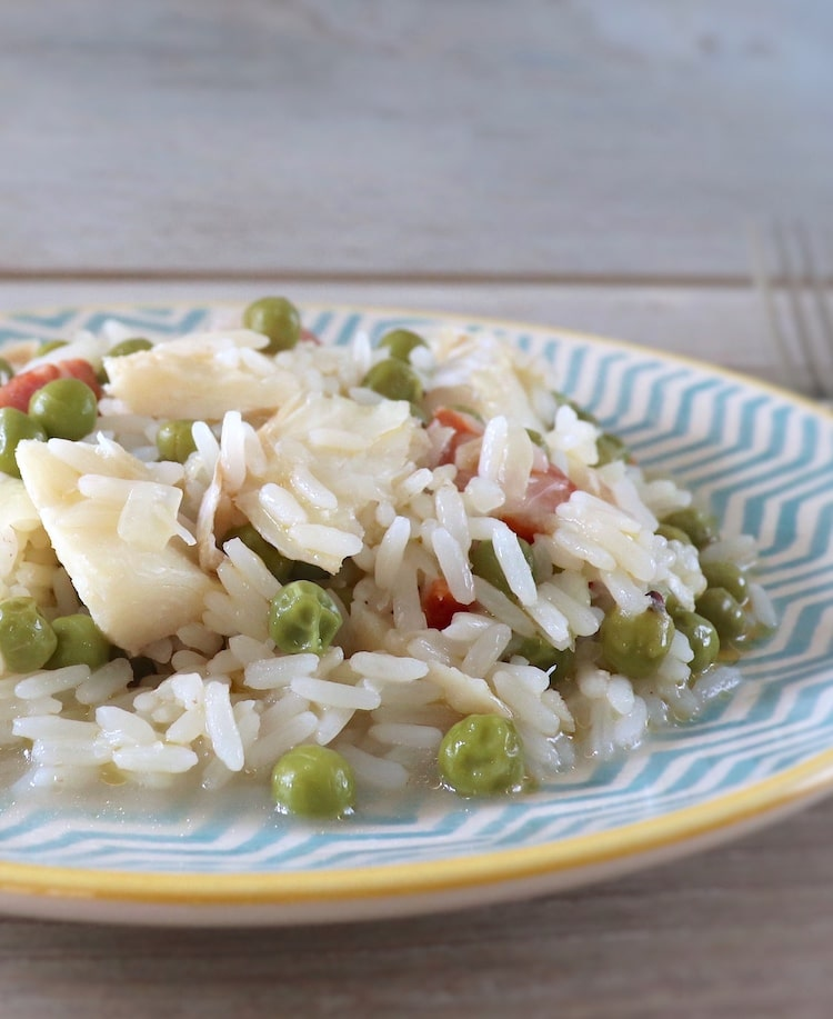 Rice with cod and peas on a plate