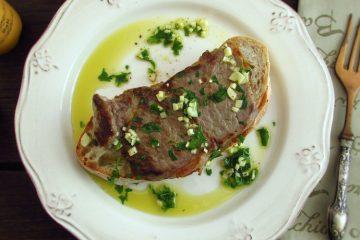 Open face steak sandwich on a plate