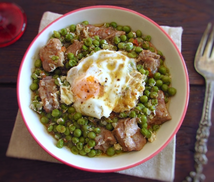 Peas with pork ribs and poached eggs on a bowl