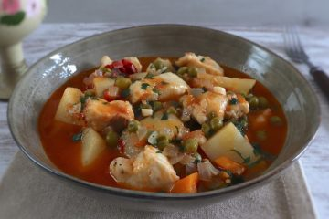Dogfish stew with potatoes, peas and carrot on a dish bowl