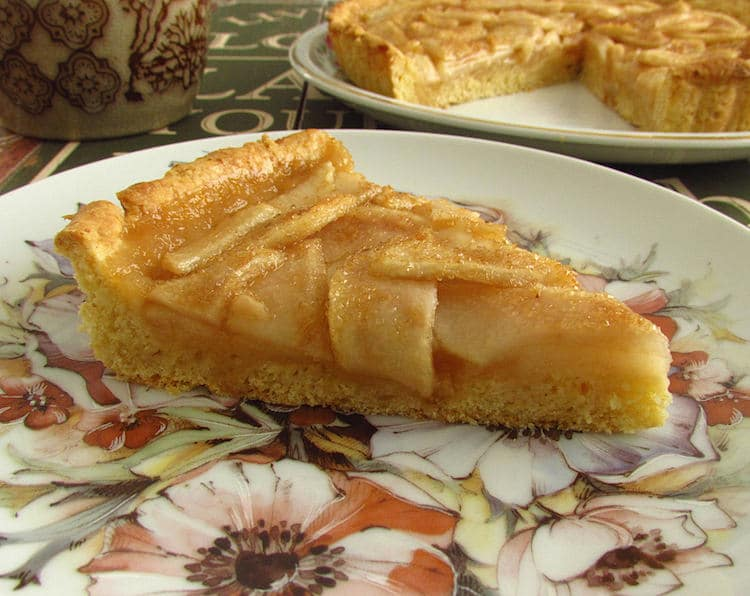 Pear and honey pie slice on a plate