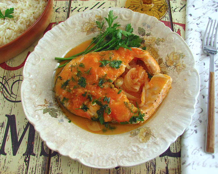Salmon in tomato sauce on a plate