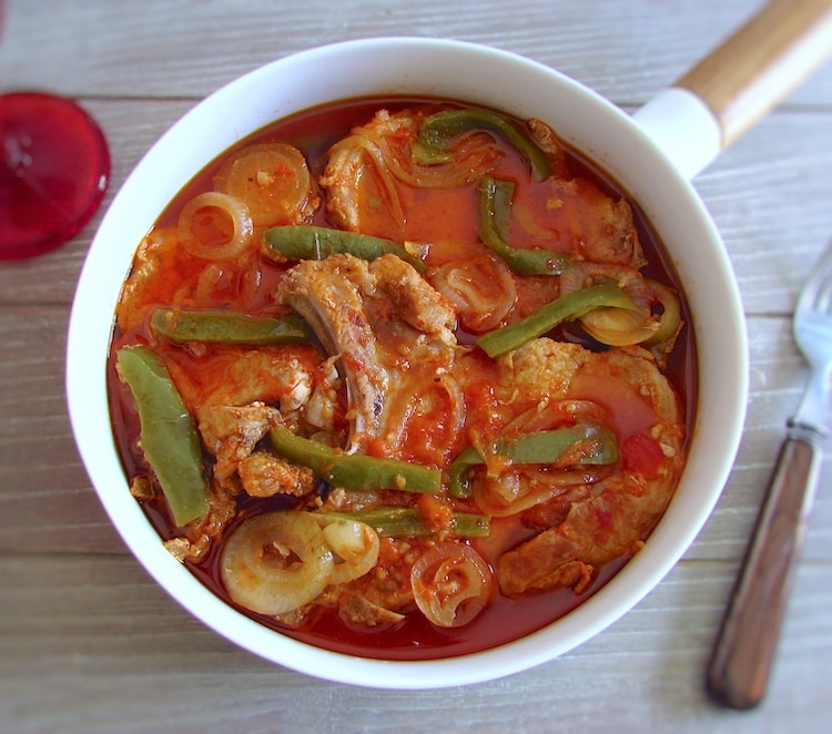 Pork chops in tomato sauce on a dish bowl