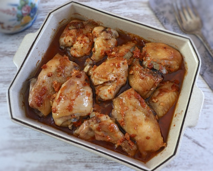Chicken in the oven with delicious sauce on a baking dish