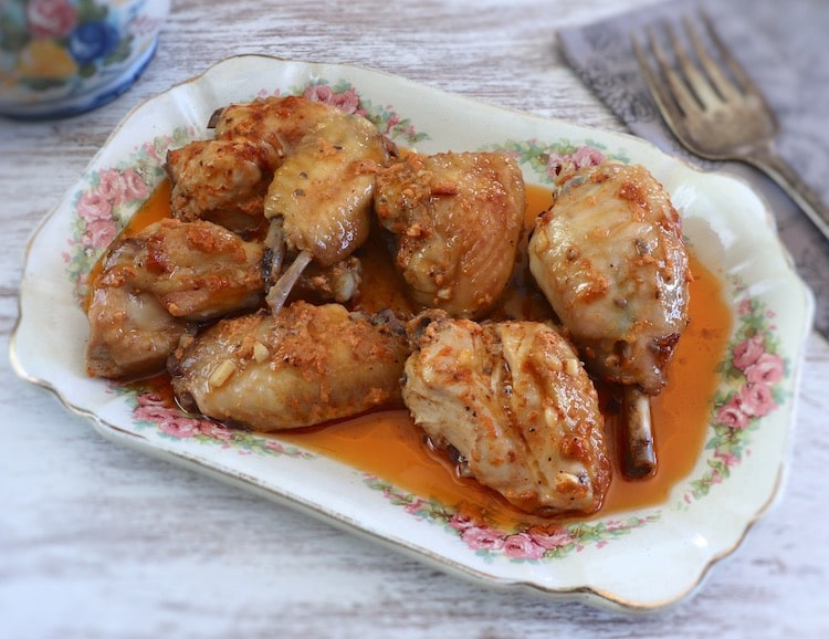 Chicken in the oven with delicious sauce on a platter