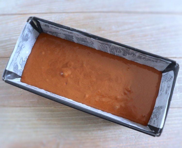 Dough of chocolate cake with caramel and honey on a loaf tin