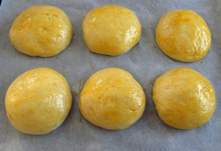 Milk bread dough filled with chocolate brushed with beaten egg yolk