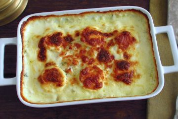 Cod in the oven with egg and béchamel on a baking dish