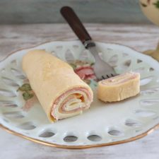 Crepe with ham and cheese on a plate