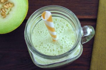 Honeydew melon milkshake on a glass cup