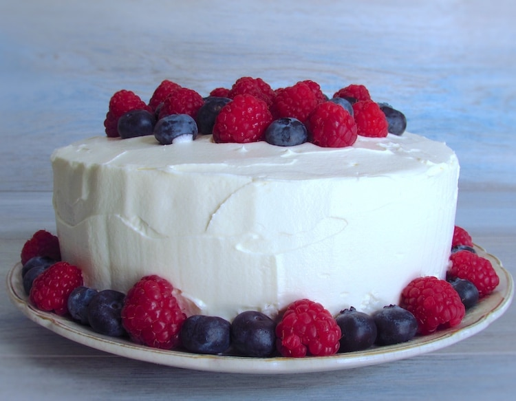 Cake with buttercream and soft fruit on a plate