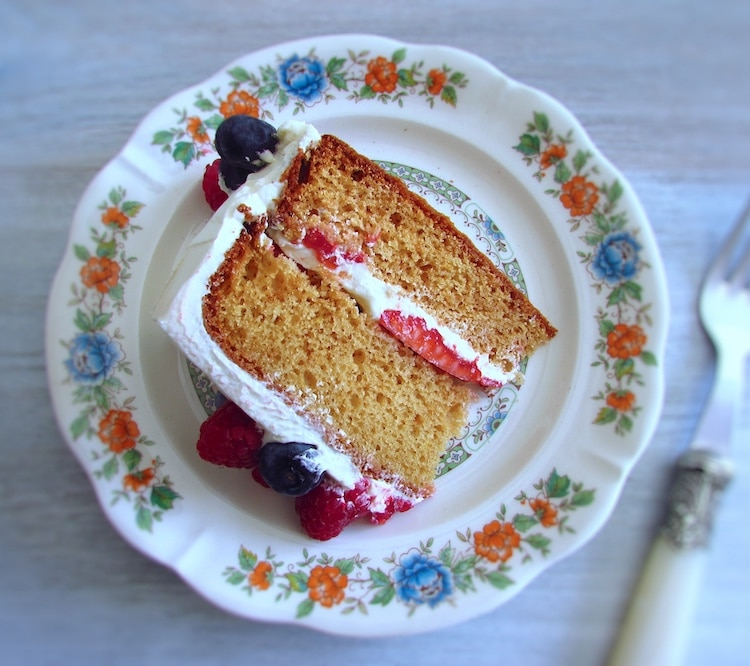 Cake with buttercream and soft fruit slice on a plate
