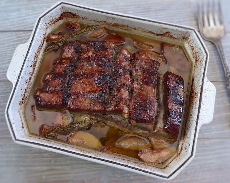 Pork ribs with apple in the oven on a baking dish