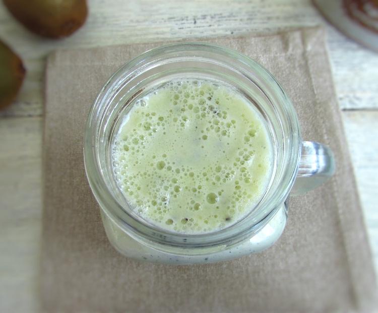 Kiwi milkshake on a cup