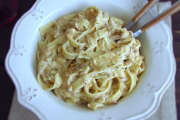 Tagliatelle with tuna and egg on a dish bowl