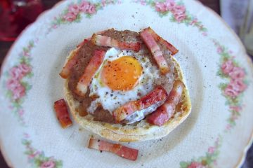 Burgers with egg and bacon on a plate