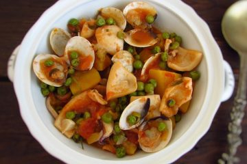 Cuttlefish with clams, peas and sweet potato served on a terrine