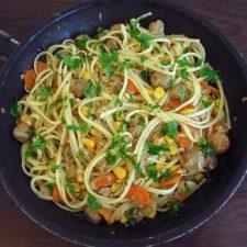 Spaghetti with tuna, corn and mushrooms on a frying pan