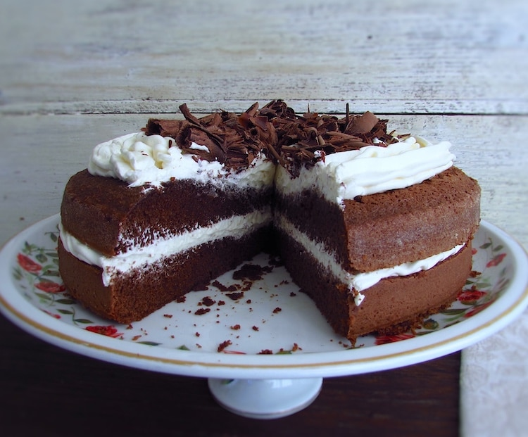 Chocolate cake with butter cream on a plate