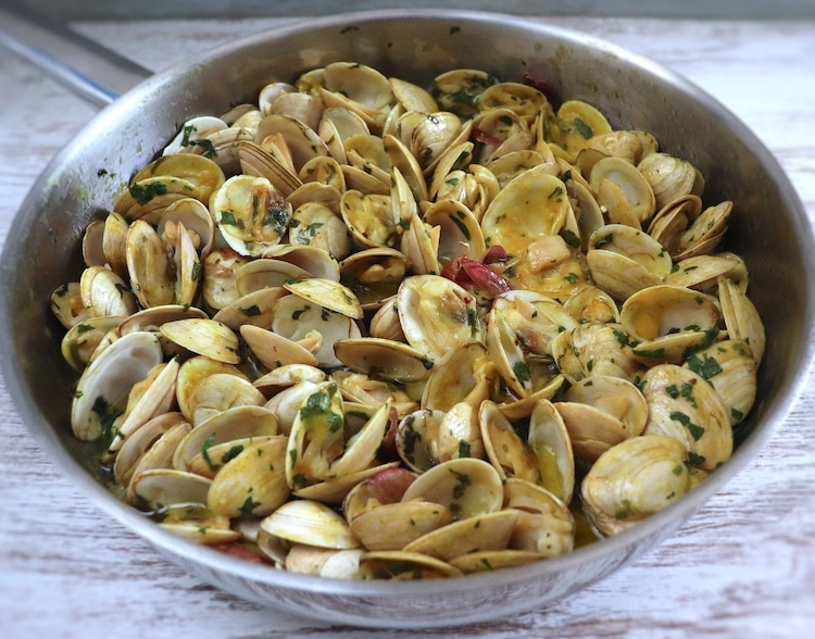 Clams with mustard on a frying pan
