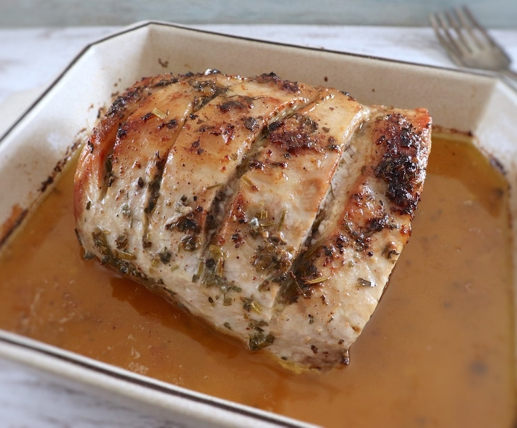 Pork loin with spices on a baking dish
