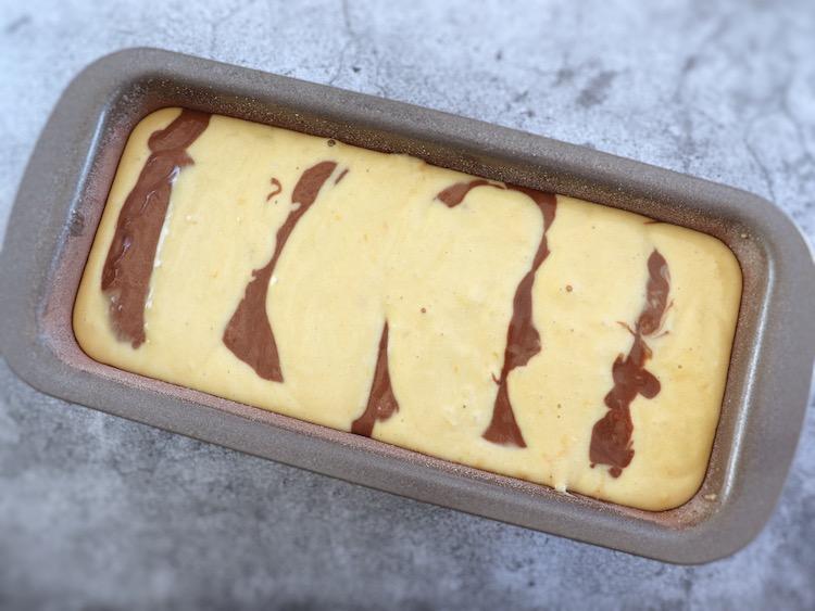 Chocolate lemon marble cake dough on a loaf tin