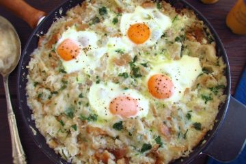 Portuguese migas (crumbs) with poached eggs in a frying pan